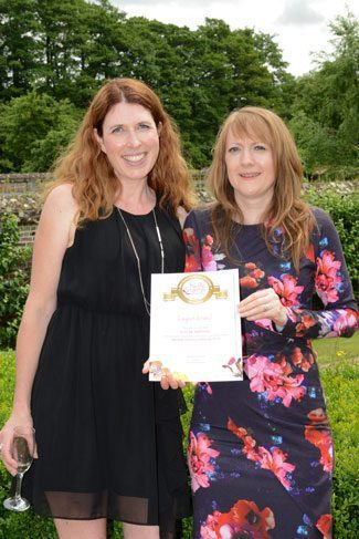 Louisa receives her Muddy Stilettos Award