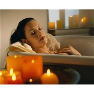 Image of lady relaxing with candles