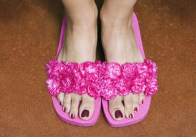 Close-up of a woman's foot with slippers
